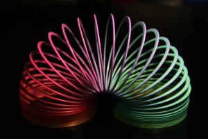 Creative Commons Slinky Rainbow by Enoch Lau is licensed under CC by 1.0